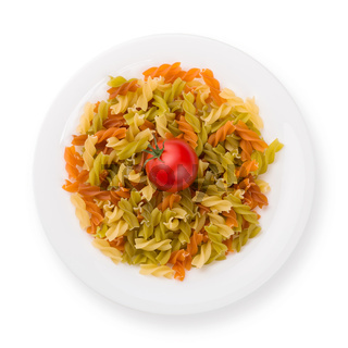 Plate of pasta with tomato from above isolated