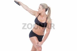 Female athlete throwing discus