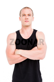 Athlete standing with arms crossed