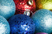 many colored Christmas balls on the background