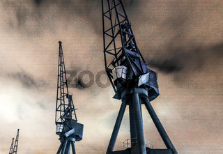 Royal Victoria Dock disused industrial cranes at night, Docklands, London, United Kingdom