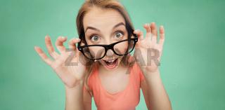 happy young woman or teenage girl in eyeglasses