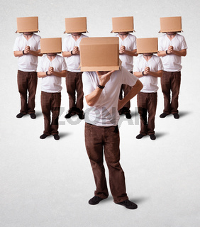 People gesturing with empty box on their head