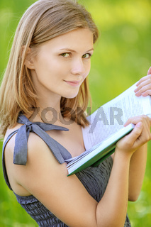 beautiful young blond woman with book