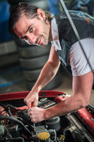 Car mechanic in auto repair service