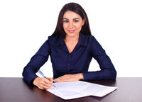 Portrait of a cheerful business woman sitting on her desk Adan sign up contract on white background