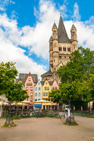 Colorful houses and Great St. Martin Church Cologne, Germany