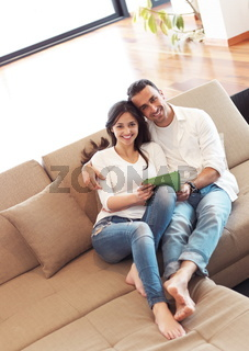 couple at modern home using tablet computer