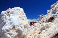 Winter scenery with piles of snow and a train on the top of Pikes Peak Mountain
