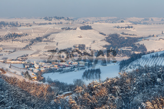Small town among snowy hills in Italy.