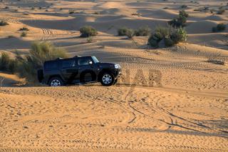 Driving on jeeps Desert Safari