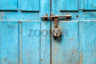Padlock on a blue door