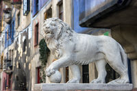 Lion statue in front of Hundertwasser House