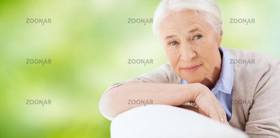 happy senior woman resting on sofa