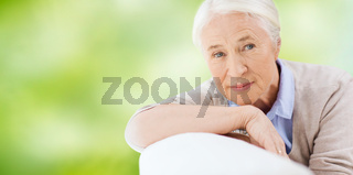 happy senior woman resting on sofa