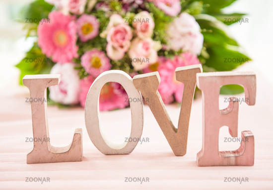 LOVE in front of colorful bouquet