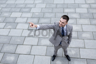 young smiling businessman outdoors from top