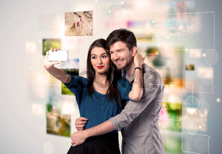Happy young couple taking selfie pictures