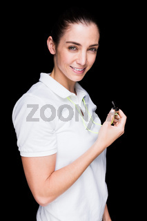 Female athlete holding a whistle