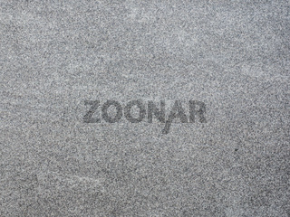 Grauer Stein mit Maserung als Hintergrund