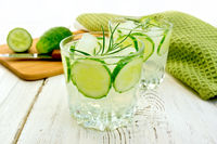 Lemonade with cucumber and rosemary in two glassful on board