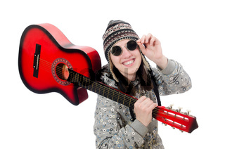 Young optimistic girl holding guitar isolated on white