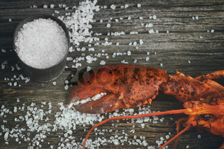 Cooked lobster claw with sea salt on wood