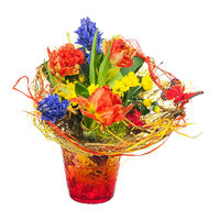 Colorful flower bouquet in red vase isolated on white background.