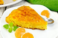 Pie mandarin with mint and spoon on board