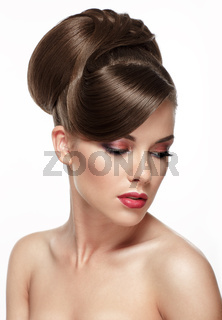 Beautiful woman with fashion wedding hairstyle and colourful makeup - on white background