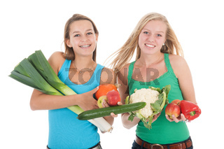 Teen girlfriends with fresh vegetables and fruit