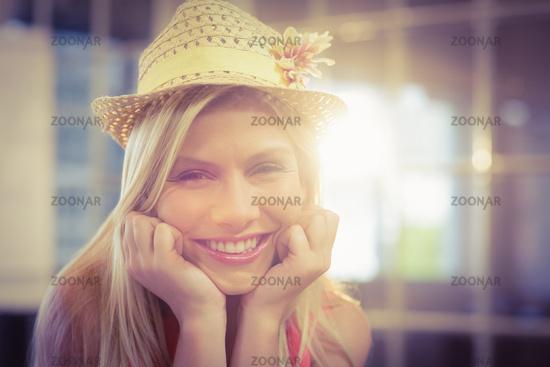 Portrait of happy businesswoman wearing hat