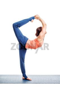 Woman doing yoga asana Natarajasana