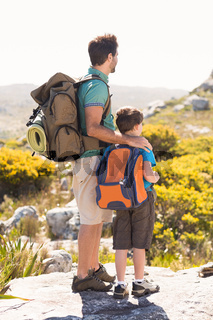 Father and son hiking through mountains