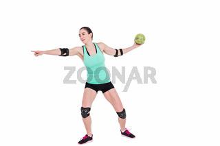 Female athlete with elbow pad throwing handball