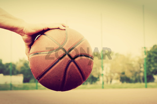 Dribbling the ball on basketball court. Streetball