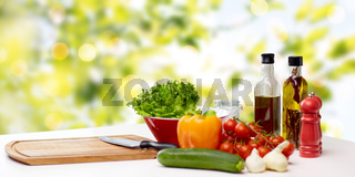 vegetables, spices and kitchenware on table
