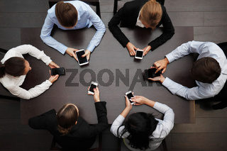 business people with mobile phones