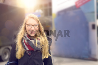 Smiling attractive blond woman in winter fashion