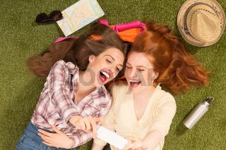 Happy girls making selfies
