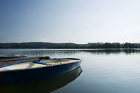 Ruderboot auf dem See ### rowboat on a lake Ruderboot auf dem See ### rowboat on a lake