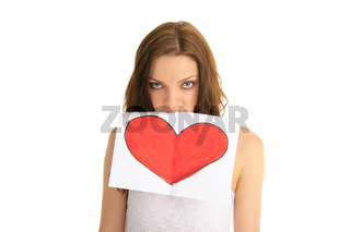 young woman holds in her teeth painted heart