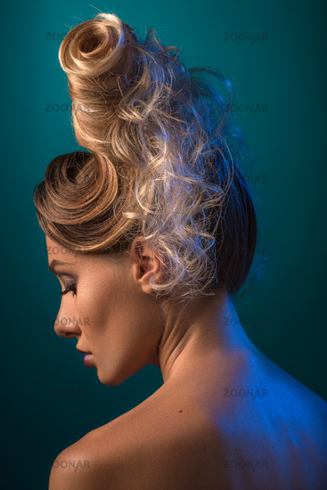 Woman with Futuristic Hairdo. Updo.