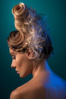 Woman with Futuristic Hairdo. Updo.