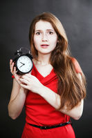 girl in red dress late with alarm clock