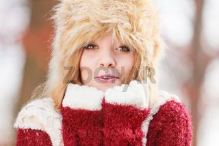 Portrait of pretty fashion woman in fur winter hat