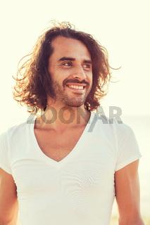 smiling man in white blank shirt outdoors