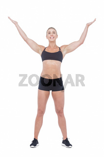 Female athlete raising her arms
