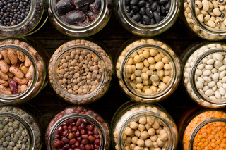 various dried legumes in jars