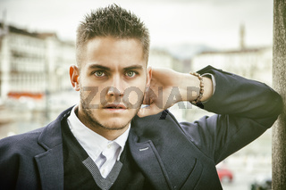 Handsome young man outdoor in jacket and shirt